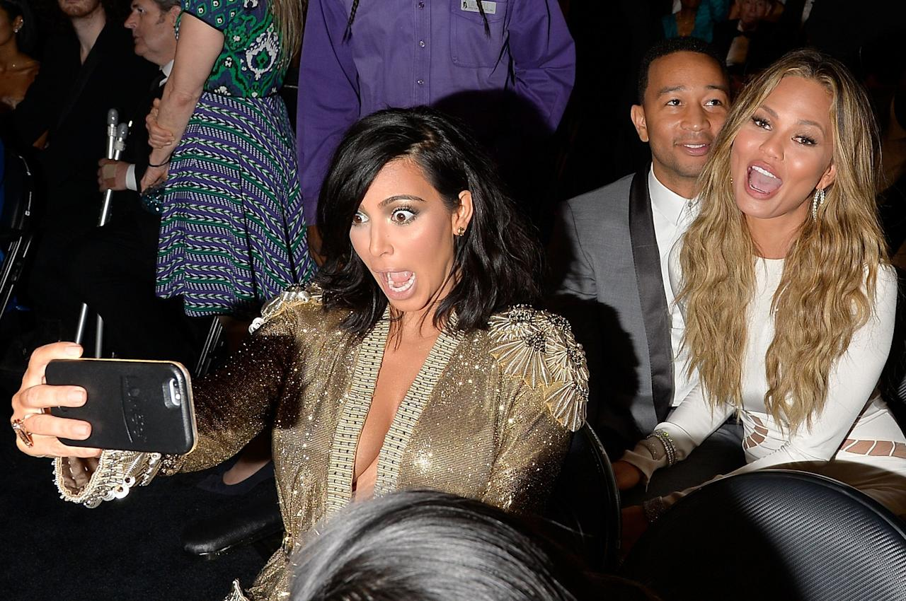 <p>Today marks the release of Kim Kardashian's new selfie-filled coffee table book, <em>Selfish</em>. To celebrate, here are some of the best photos of celebrities snapping selfies that would make even Kim proud, from Hillary Clinton to Paris Hilton.</p>