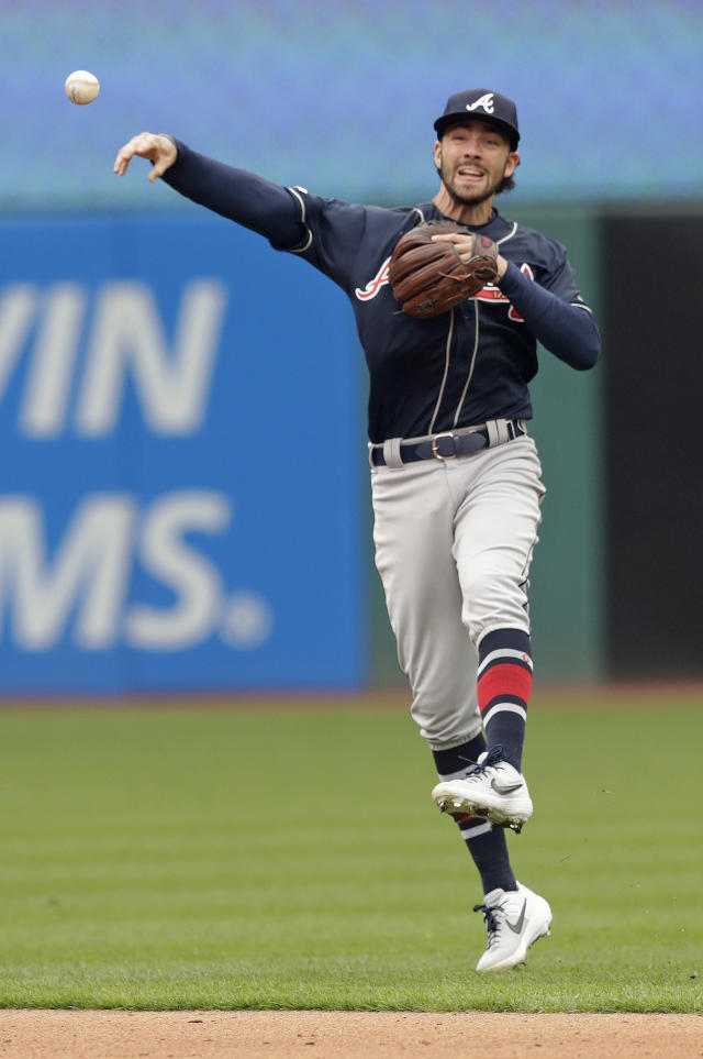 Atlanta Braves' Dansby Swanson throws out Cleveland Indians' Leonys Martin at first base in the fourth inning during the first game of a baseball doubleheader, Saturday, April 20, 2019, in Cleveland. (AP Photo/Tony Dejak)