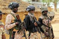 Nigeria's armed forces are struggling with a jihadist insurgency, as well as ethnic unrest and brutal attacks by criminal gangs (AFP/AUDU MARTE)