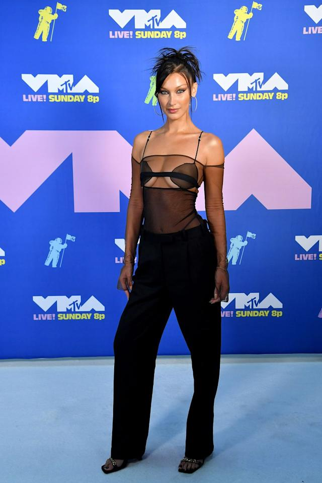 <p>Bella Hadid walked the red carpet in a sheer top and trousers by Albanian designer, Nensi Dojaka.</p>
