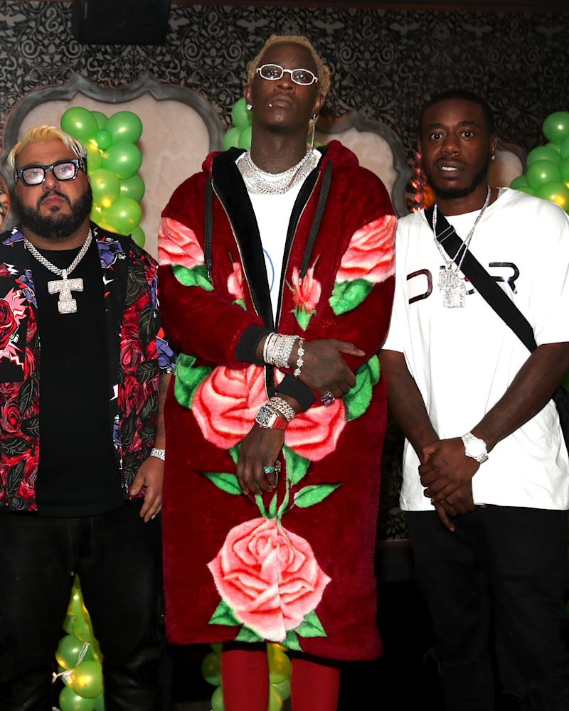 Young Thug celebrates his new album (and birthday!) as only Young Thug can: in an enormous rose-printed hoodie-slash-robe.