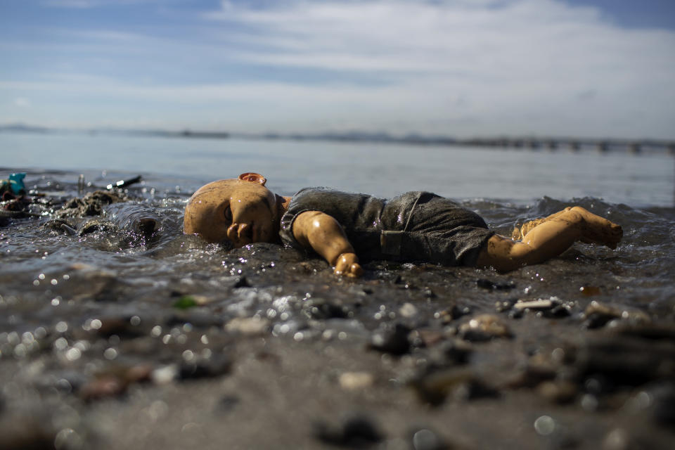 A discarded doll lays atop trash littering the coast of Guanabara Bay in Rio de Janeiro, Brazil, Thursday, June 24, 2021. Demolition of an elevated highway allowed for sweeping views of the bay where the 2016 Rio de Janeiro Olympics sailing competitions took place, but its waters weren't cleaned of sewage, as had been promised. (AP Photo/Bruna Prado)