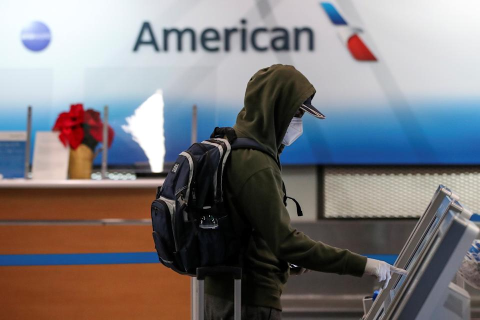 A traveler checks-in for a flight at O'Hare International Airport ahead of the Thanksgiving holiday during the coronavirus disease (COVID-19) pandemic, in Chicago, Illinois, U.S. November 25, 2020. REUTERS/Kamil Krzaczynski