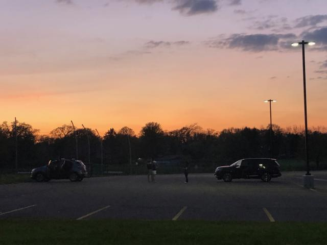 Hours after the Class of 2020 parade ended, Cary-Grove High School staff — who haven't seen each other in months — stuck around just to catch up. (Eric Edholm/Yahoo Sports)