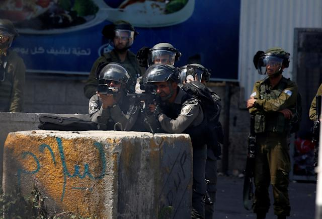 <p>Israeli security forces intervene to Palestinian demonstrators during a protest, organized to mark 70th anniversary of Nakba, also known as Day of the Catastrophe in 1948, and against United States' plans to relocate the U.S. Embassy from Tel Aviv to Jerusalem in Bethlehem, West Bank on May 15, 2018. (Photo: Wisam Hashlamoun/Anadolu Agency/Getty Images) </p>