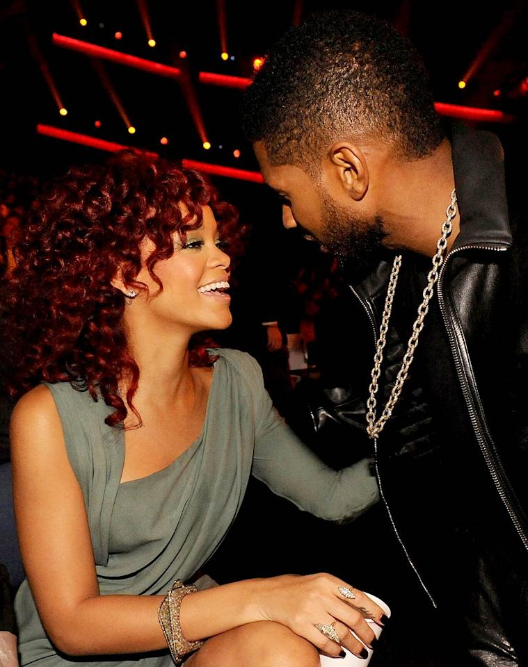 "<i>OK!</i> reports Rihanna and Usher are ""hooking up."" According to the magazine, while at the Coachella music festival, the two were ""making beautiful music together -- and we're not talking about singing."" <i>OK!</i> says at one of the festival's parties, Usher and Rihanna were ""flirty"" and holding hands. And while Leonardo DiCaprio was, at one point, chatting up Rihanna, ""she went home with Usher."" For exclusive details about when this romance began and where it's going, log on to <a href=""http://www.gossipcop.com/rihanna-usher-hooking-up-coachella-2011-hookup/"" target=""new"">Gossip Cop</a>. Jeff Kravitz/<a href=""http://www.filmmagic.com/"" target=""new"">FilmMagic.com</a> - November 21, 2010"