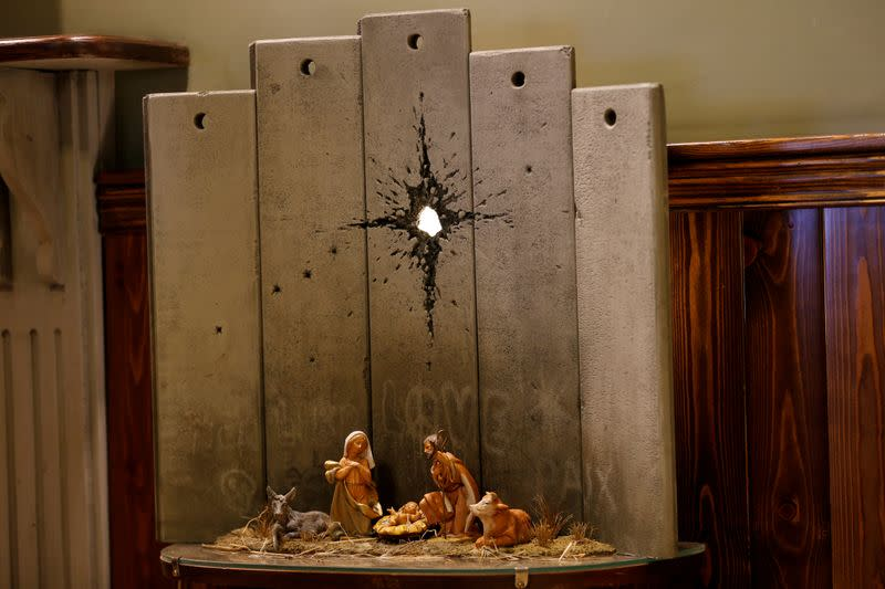 """Artwork dubbed """"scar of Bethlehem"""" by street artist Banksy is displayed in the Walled Off hotel, in Bethlehem in the Israeli-occupied West Bank"""