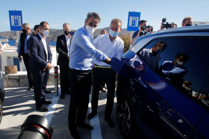 Greek PM Mitsotakis and Volkswagen AG CEO Herbert Diess attend a delivery ceremony of electric cars in the island of Astypalea
