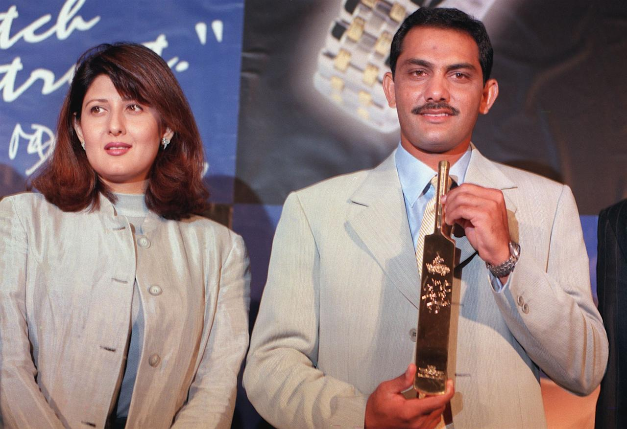 Indian skipper Mohammed Azaruddin (R) with wife Sangeeta,was presented a memento 21 April 1999 wishing him and the India Cricket team good luck for the forth coming cricket World Cup in England. The memento was presented by a Swiss watch manufacturing company, Tissot at a hotel in south Bombay.