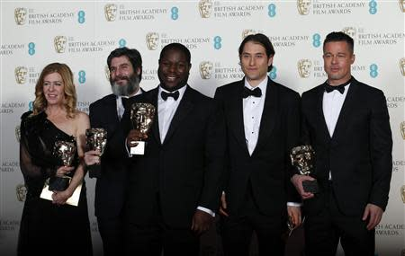 "Director Steve McQueen (C) celebrates with Dede Gardner (L-R), Anthony Katagas, Jeremy Kleiner and Brad Pitt after winning Best Film for ""12 Years a Slave"" at the British Academy of Film and Arts (BAFTA) awards ceremony at the Royal Opera House in London February 16, 2014. REUTERS/Suzanne Plunkett"