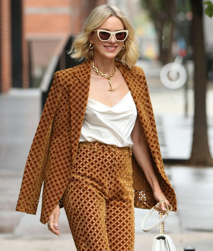 <p>Naomi Watts in Oscar de la Renta on her way to kick off NYFW: The Shows by lighting the Empire State Building on Sept. 9.</p>