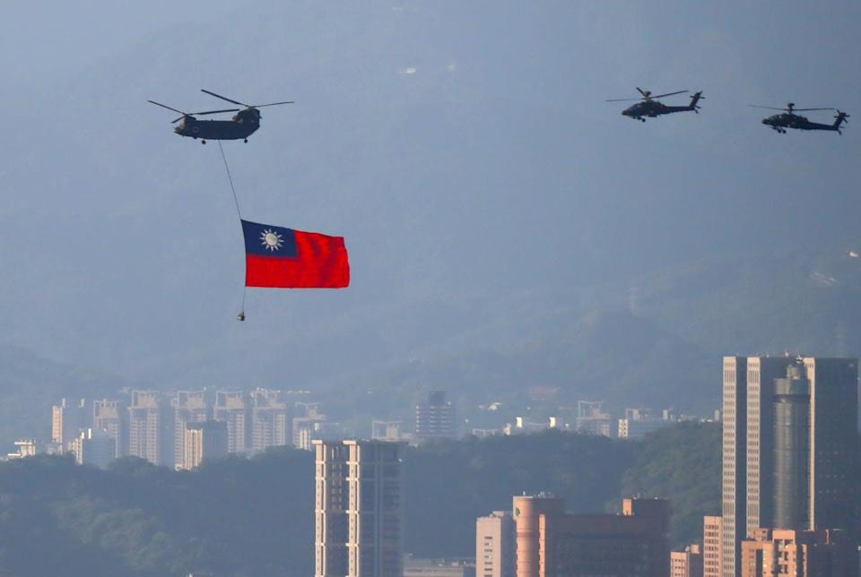 """<span class=""""caption"""">Taiwanese helicopters fly above Taipei rehearsing for a national celebration day, October 5.</span> <span class=""""attribution""""><span class=""""source"""">GettyImages</span></span>"""