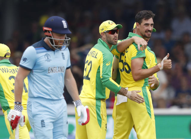 Australia's Mitchell Starc turns and give a thumbs up towards the dressing room after taking the wicket of England's captain Eoin Morgan during their Cricket World Cup match between England and Australia at Lord's cricket ground in London, Tuesday, June 25, 2019. (AP Photo/Alastair Grant)