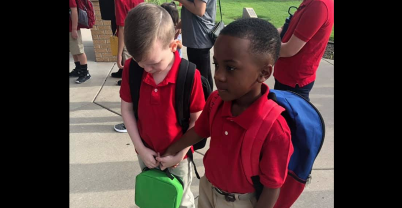 An 8-year-old boy is going viral after he took the hand of his classmate, who has autism, and helped him cope with an overwhelming first day of school. (Photo: Facebook)