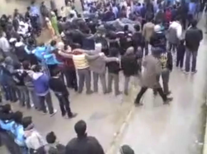 This image from amateur video made available by the Ugarit News group and shot on Thursday, Jan. 12, 2012, purports to show protesters demonstrating against the killing of a French journalist in Hama, Syria.(AP Photo/Ugarit News Group via APTN) THE ASSOCIATED PRESS CANNOT INDEPENDENTLY VERIFY THE CONTENT, DATE, LOCATION OR AUTHENTICITY OF THIS MATERIAL.  TV OUT
