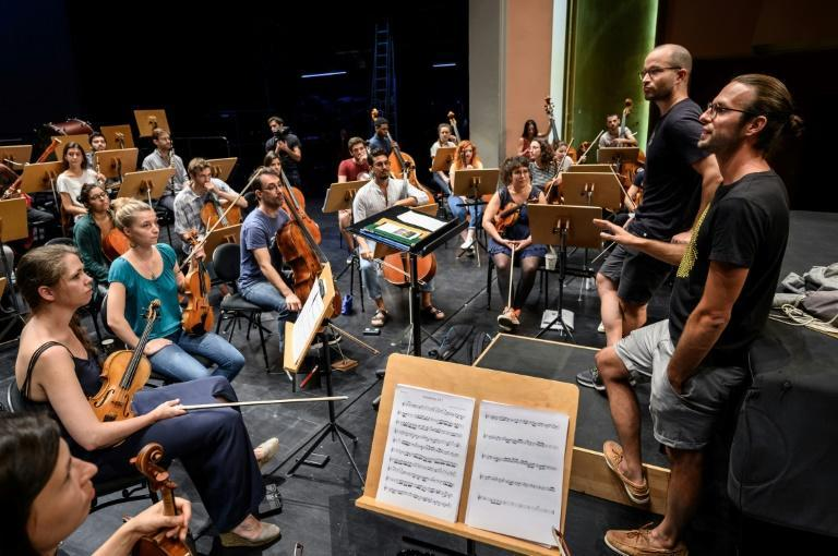 The excitement was palpable as the freshly created sheet music was presented to the orchestra (AFP/Fabrice COFFRINI)