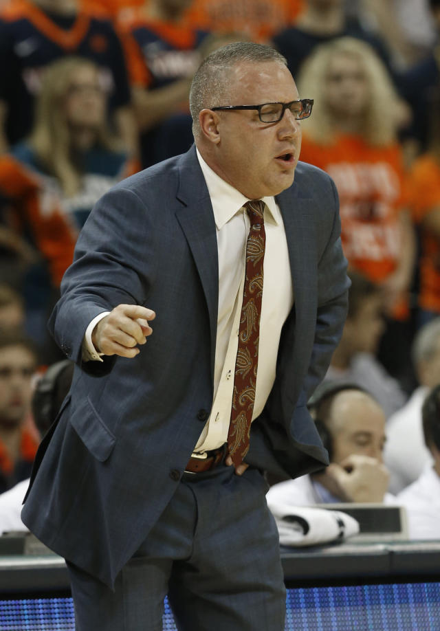 Virginia Tech head coach Buzz Williams directs his team during the first half of an NCAA college basketball game against Virginia, in Charlottesville, Va., Tuesday, Jan. 15, 2019. (AP Photo/Steve Helber)