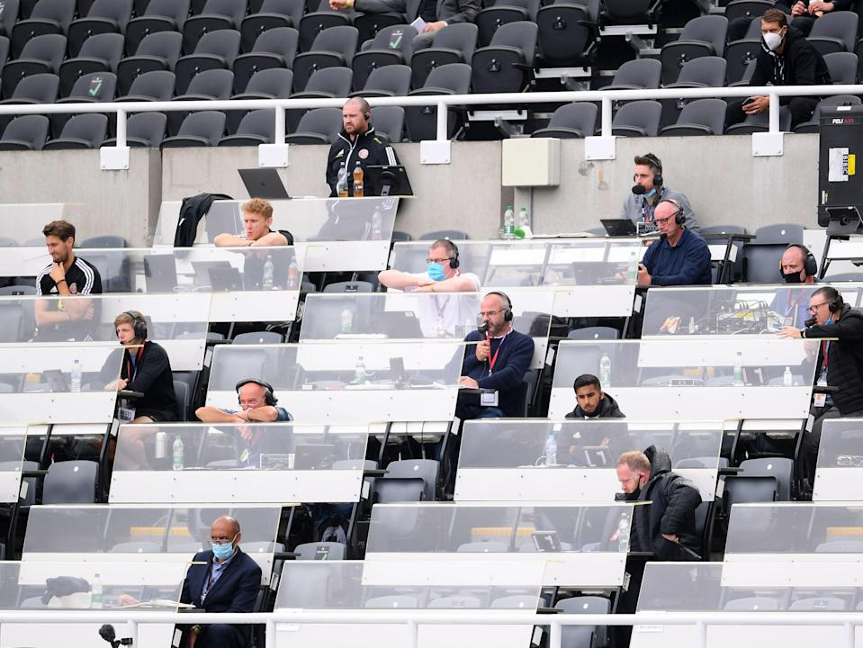 Journalists watch on from a press box (POOL/AFP via Getty Images)