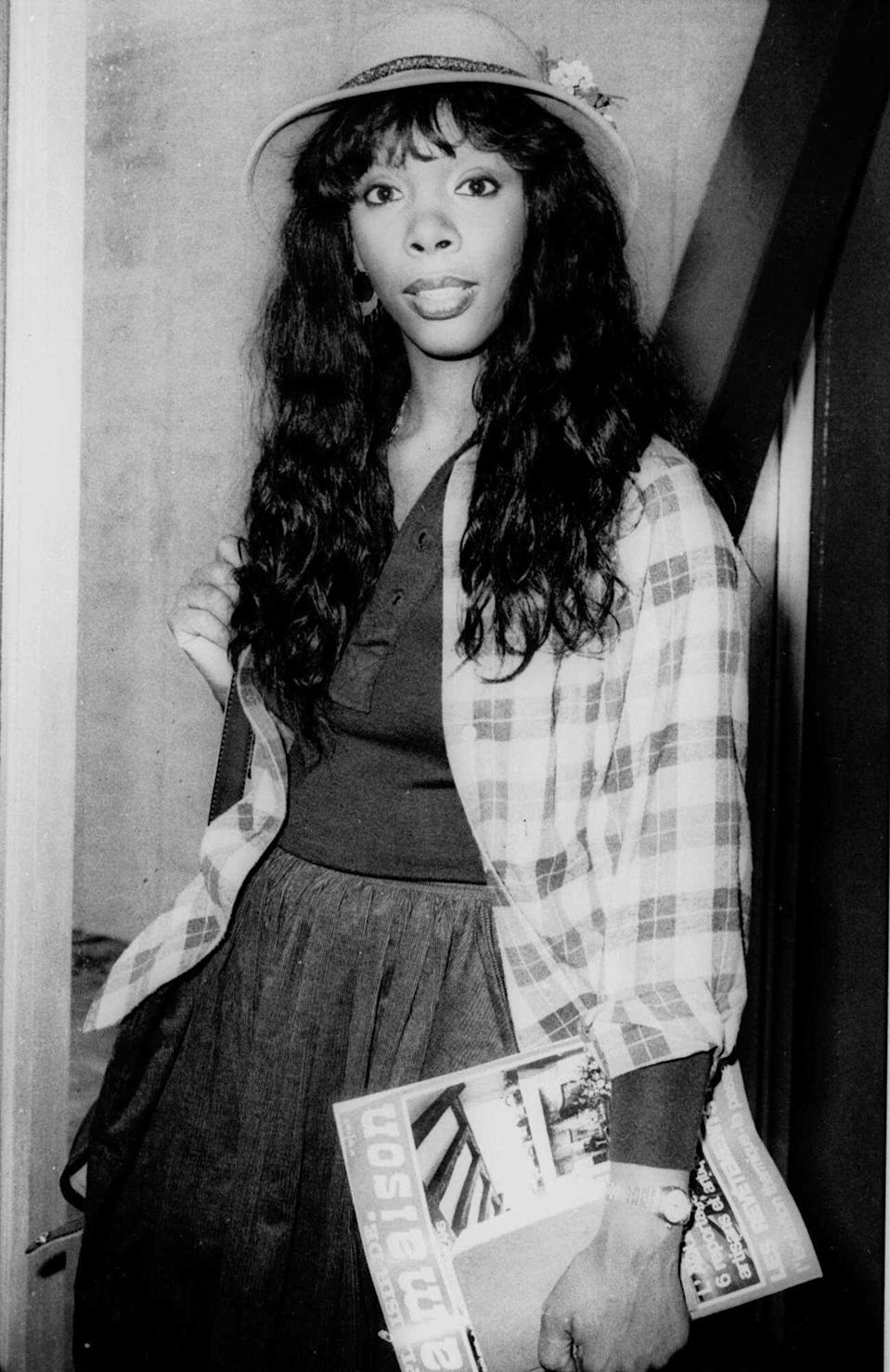 """FILE - In this Oct. 21, 1977 file photo, Donna Summer, 27, arrives at Heathrow Airport from Paris. Summer, the Queen of Disco who ruled the dance floors with anthems like """"Last Dance,"""" """"Love to Love You Baby"""" and """"Bad Girl,"""" has died. Her family released a statement, saying Summer died Thursday, May 17, 2012. She was 63. (AP Photo/File)"""