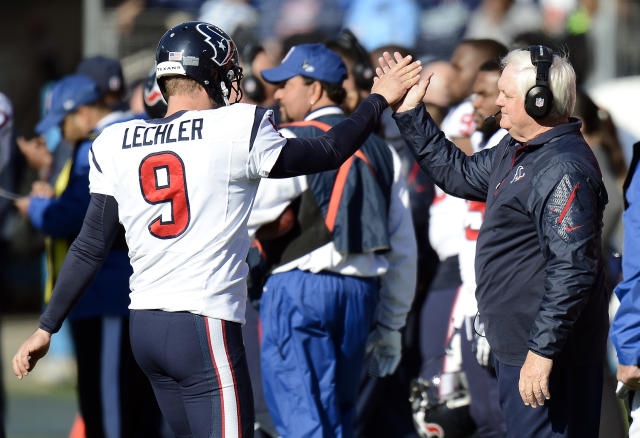 Houston Texans interim head coach Wade Phillips, right, congratulates punter Shane Lechler (9) after a kick against the Tennessee Titans in the second quarter of an NFL football game Sunday, Dec. 29, 2013, in Nashville, Tenn. (AP Photo/Mark Zaleski)