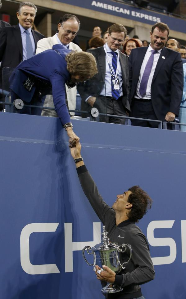Nadal of Spain holds his trophy as he shakes hands with Queen Sofia of Spain after defeating Djokovic of Serbia in their men's final match at the U.S. Open tennis championships in New York