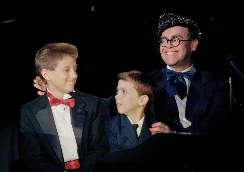 """AIDS activist Ryan White is seen far left of British pop singer Elton John at the """"For the Love of Children"""" benefit for children with AIDS and other serious illnesses in Los Angeles in 1988. (ASSOCIATED PRESS)"""