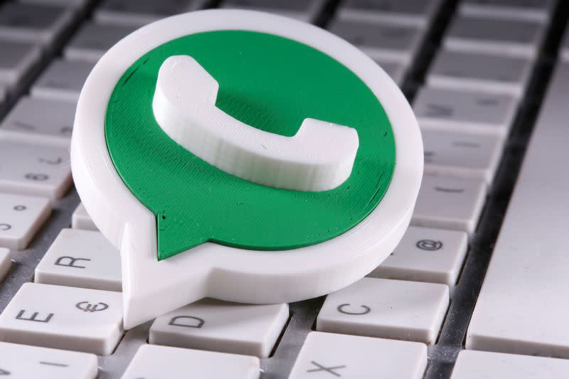 A 3D printed Whatsapp logo is placed on the keyboard in this illustration taken