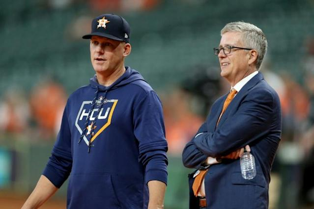 Banned: Astros skipper A.J. Hinch (left) and general manager Jeff Luhnow have been banned for the entirety of the 2020 season over allegations of cheating in 2017 (AFP Photo/Bob Levey)
