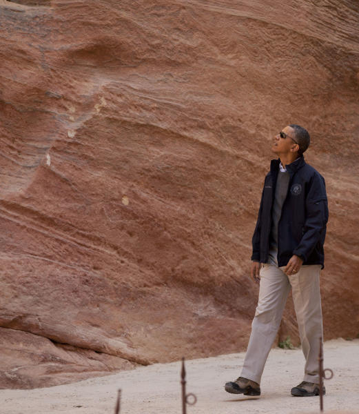 U.S. President Barack Obama looks up as he walks through the Siq during a visit to the ancient city of Petra, in south Jordan, Saturday, March 23, 2013. (AP Photo/Carolyn Kaster)