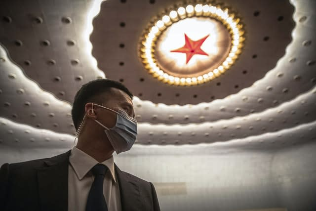 A security official wearing protective face mask stands guard before the second plenary session of China's National People's Congress (NPC) at the Great Hall of the People in Beijing