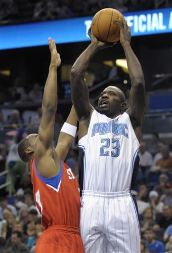 Orlando Magic guard Jason Richardson, right, goes up for a shot in front of Philadelphia 76ers guard Jodie Meeks during the first half of an NBA basketball game in Orlando, Fla., Wednesday, Feb. 15, 2012. (AP Photo/Phelan M. Ebenhack)
