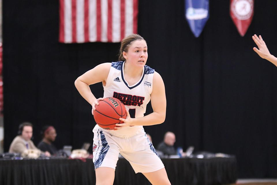 University of Detroit Mercy guard Abbie McDowell (Tecumseh) looks to pass the ball during a game for the Titans.