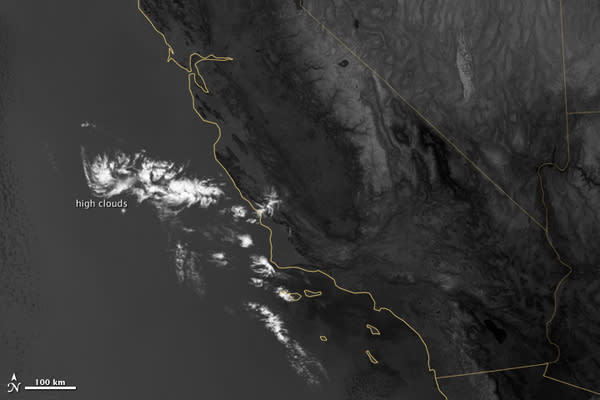 This image shows a layer of high clouds seen at night in the thermal infrared specturm of light. A lower level of marine layer clouds sitting below is invsible in this band of light because their temperature is too close to the ground to disti