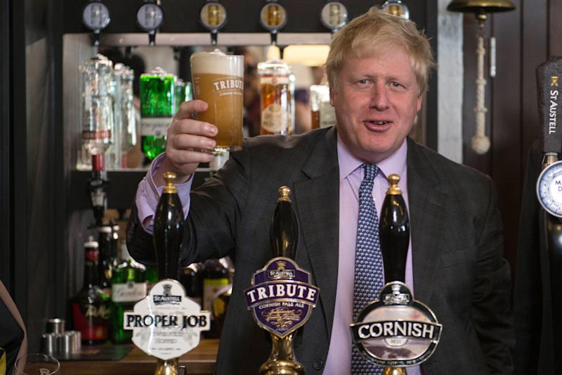 Former Mayor of London Boris Johnson drinks a pint of beer on a visit to the St Austell Brewery in Cornwall, during a Vote Leave campaign visit.