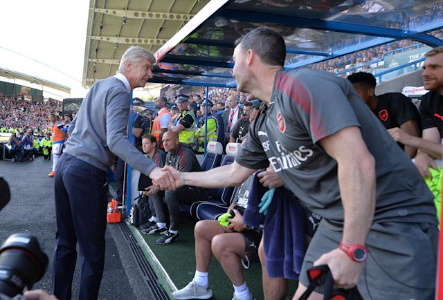 "Soccer Football - Premier League - Huddersfield Town vs Arsenal - John Smith's Stadium, Huddersfield, Britain - May 13, 2018 Arsenal manager Arsene Wenger shakes hands with Arsenal's head of performance Shad Forsythe REUTERS/Peter Powell EDITORIAL USE ONLY. No use with unauthorized audio, video, data, fixture lists, club/league logos or ""live"" services. Online in-match use limited to 75 images, no video emulation. No use in betting, games or single club/league/player publications. Please contact your account representative for further details."
