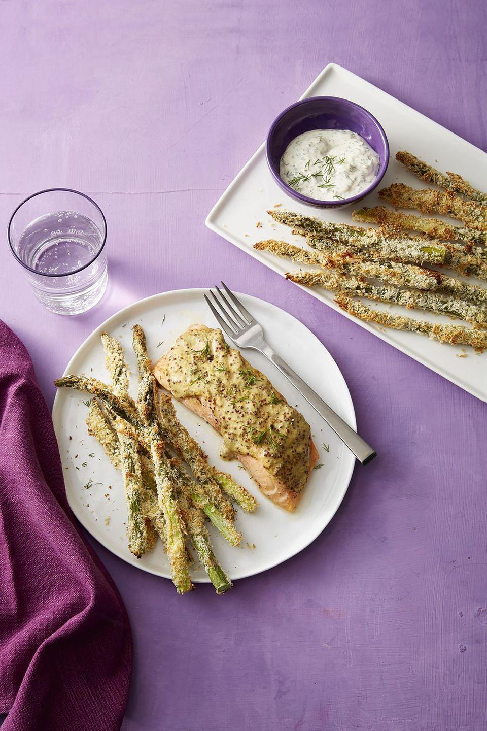 """<p>An alternative to french fries, these asparagus """"fries"""" are topped with panko bread crumbs and are a great addition to a salmon dinner. </p><p><a href=""""https://www.womansday.com/food-recipes/a19156229/mustard-dill-salmon-with-crispy-asparagus-fries-recipe/"""" rel=""""nofollow noopener"""" target=""""_blank"""" data-ylk=""""slk:Get the recipe for Mustard-Dill Salmon with Crispy Asparagus Fries."""" class=""""link rapid-noclick-resp""""><em>Get the recipe for Mustard-Dill Salmon with Crispy Asparagus Fries.</em></a></p>"""