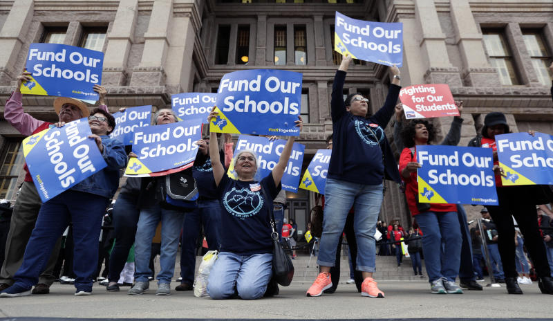 In this March 11, 2019, photo, Educators attend a rally to support funding for public schools at the state Capitol in Austin, Texas. Cost-cutting states are trying to keep schools happy as teacher unrest over low pay and overcrowded classrooms continues. But pressure from voters is forcing states to put more money on the table as much as much as picket lines. (AP Photo/Eric Gay)