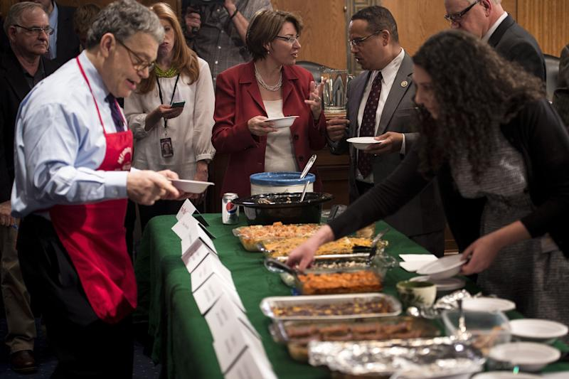 Members of the Minnesota delegation taste each other's entries during the Minnesota Congressional Delegation Hotdish Competition on Capitol Hill on April 22, 2015. Hotdish is a meal similar to a casserole.