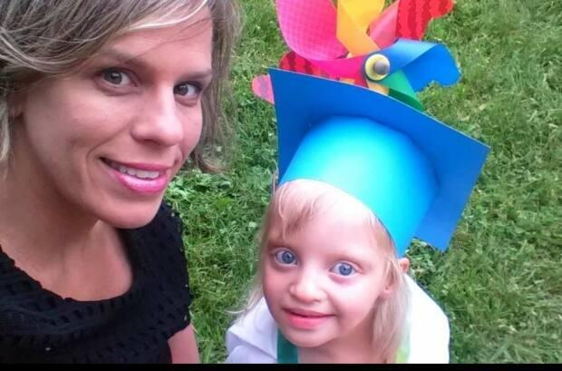 Heather and Lucy at her daycare graduation ceremony.