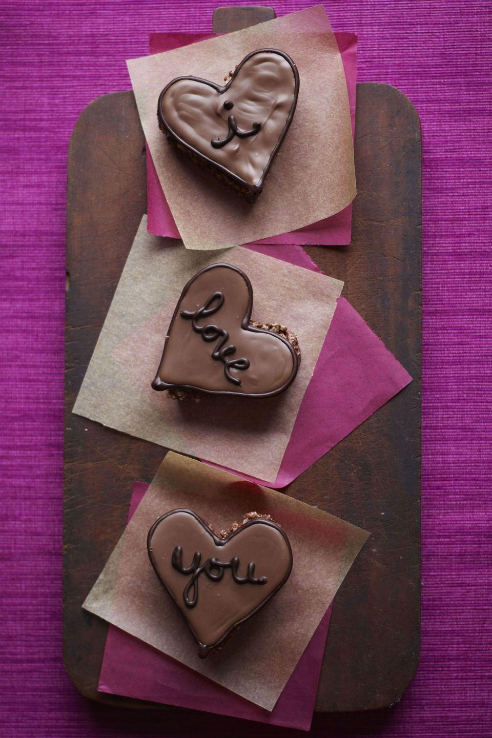 """<p>Perfect for Valentine's Day, these adorable confections could make anyone weak in the knees.</p><p><a href=""""https://www.goodhousekeeping.com/food-recipes/a14039/hazelnut-hearts-recipe-ghk0212/"""" rel=""""nofollow noopener"""" target=""""_blank"""" data-ylk=""""slk:Get the recipe for Hazelnut Hearts »"""" class=""""link rapid-noclick-resp""""><em>Get the recipe for Hazelnut Hearts »</em></a></p>"""