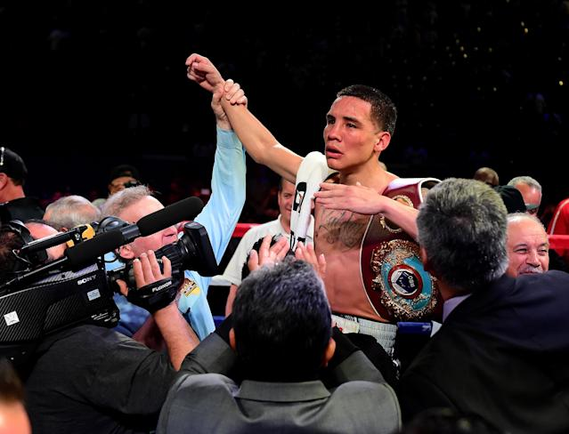 "Oscar Valdez celebrates his unanimous 12 round decision over <a class=""link rapid-noclick-resp"" href=""/olympics/rio-2016/a/1152098/"" data-ylk=""slk:Miguel Marriaga"">Miguel Marriaga</a> of Colombia during the WBO featherweight championship at StubHub Center on April 22, 2017 in Carson, California. (Photo by Harry How/Getty Images)"