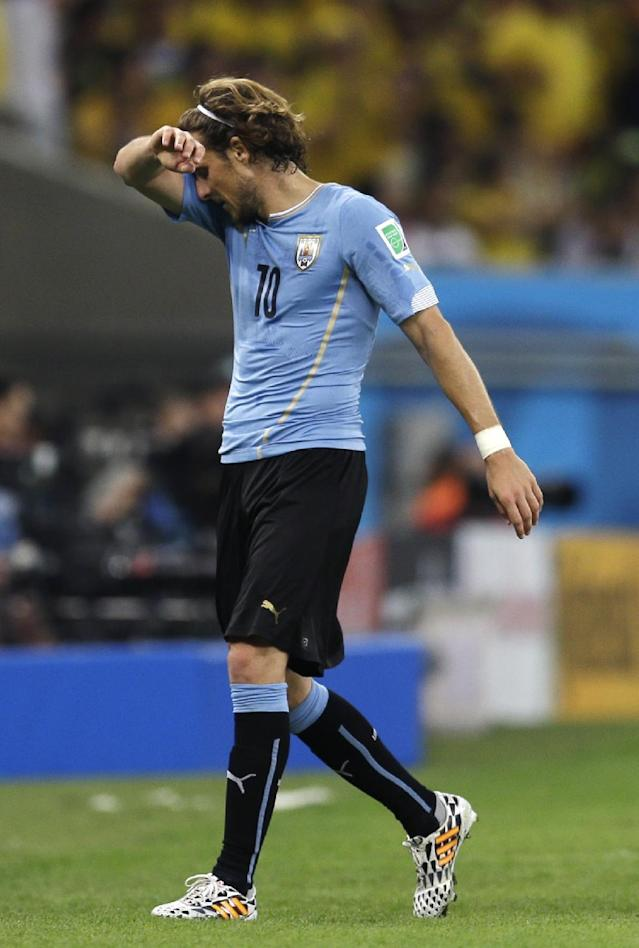 Uruguay's Diego Forlan leaves the field during the World Cup round of 16 soccer match between Colombia and Uruguay at the Maracana Stadium in Rio de Janeiro, Brazil, Saturday, June 28, 2014. (AP Photo/Natacha Pisarenko)