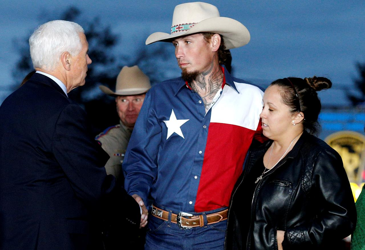 <p>Vice President Mike Pence shakes hands with Johnnie Langendorff, who was one of two men who chased the assailant, near the site of the shooting at the First Baptist Church of Sutherland Springs in Sutherland Springs, Texas, Nov. 8, 2017. (Photo: Jonathan Bachman/Reuters) </p>