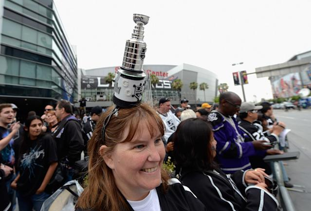 LOS ANGELES, CA - JUNE 14: Trudy De Fino, from Mission Hills, California, with a miniature Stanley Cup trophy on her head, waits for the start of the Stanley Cup victory parade on June 14, 2012 in Los Angeles, California. The Kings are celebrating thier first NHL Championship in the team's 45-year-old franchise history. (Photo by Kevork Djansezian/Getty Images)