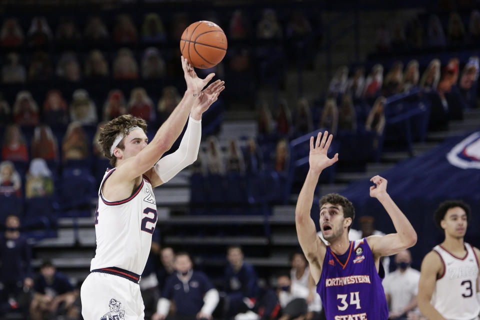 Gonzaga forward Corey Kispert, left, shoots next to Northwestern State forward Robert Chougkaz during the first half of an NCAA college basketball game in Spokane, Wash., Monday, Dec. 21, 2020. (AP Photo/Young Kwak)