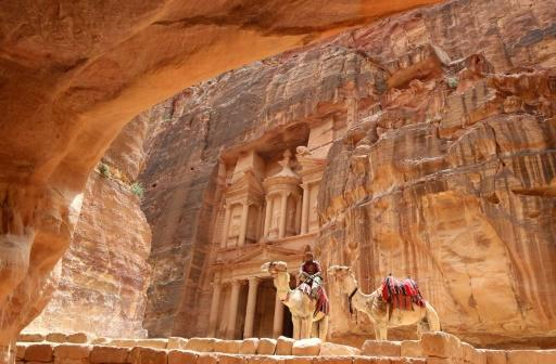 Nearly 4,000 tourists have fled Jordan's famed ancient desert city of Petra as flash floods killed 12 people in the south of the kingdom