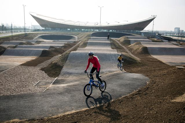 Cyclists ride the BMX track at the Lee Valley Velopark as it opens to the public.