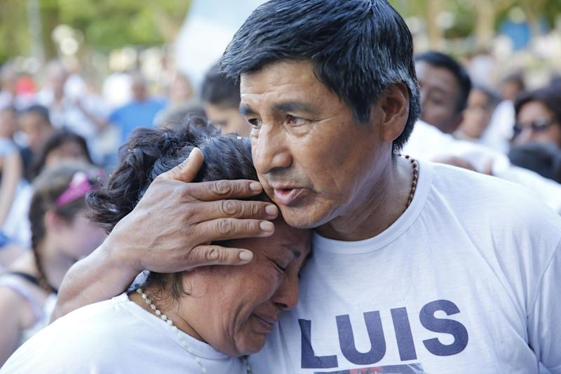 A man embraces a woman during a march organized by families of the 44 crew members of the submarine ARA San Juan: AP