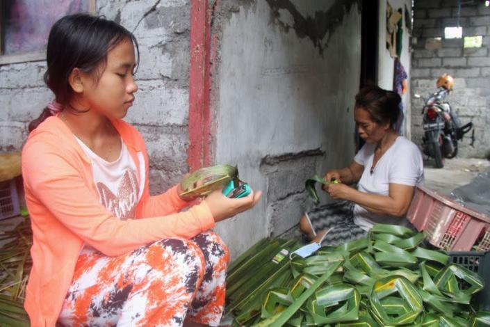 Ni Luh Nael, 13-years-old, helps her grandmother after dropping out of school the during coronavirus disease (COVID-19) pandemic in Denpasar