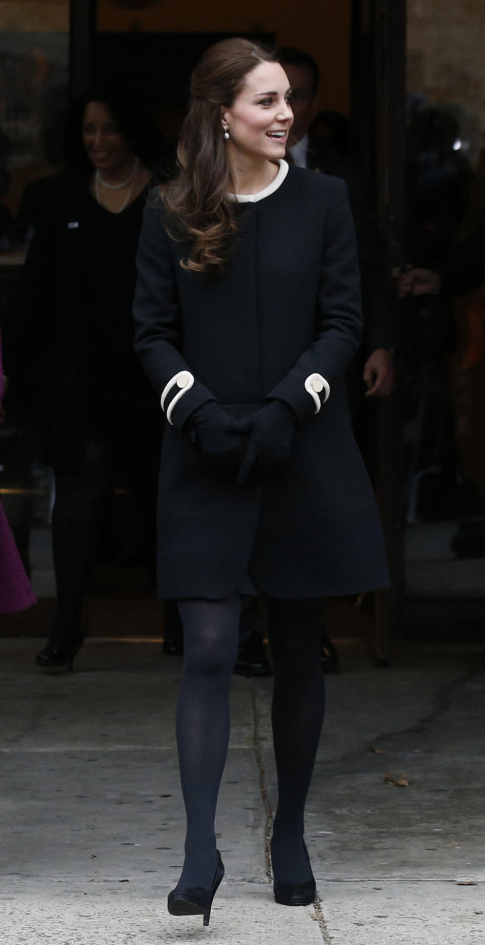 <p>For a day of engagements in New York, Kate chose a stylish black coat from Goat, coordinating shoes by Episode and a black Mulberry clutch. </p><p><i>[Photo: PA]</i></p>